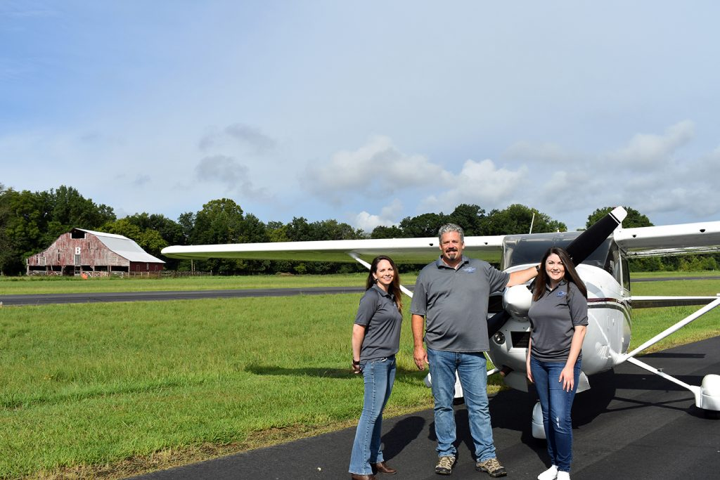 Staff-with-Plane-on-Runway